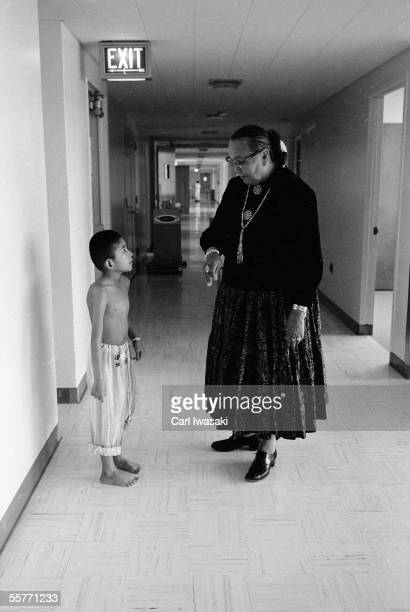 Native American activist and educator Annie Dodge Wauneka stands in the hallway of Gallup Hospital and speaks with nineyearold Robert Shorty Jr who...