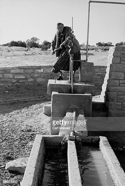Native American activist and educator Annie Dodge Wauneka works a hand water pump built by Navajos during a vast wellbuilding program designed to...