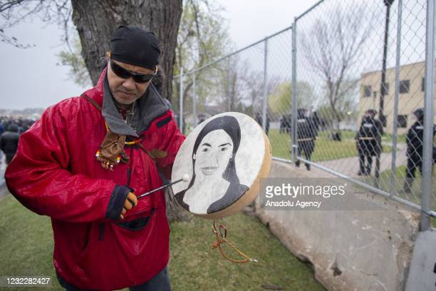 Native American activist hits a drum in front of the Brooklyn Center police department after the police killing of Daunte Wright in Brooklyn Center,...
