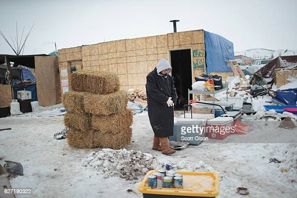 Native American activist volunteers at Oceti Sakowin Camp on the edge of the Standing Rock Sioux Reservation on December 2, 2016 outside Cannon Ball,...