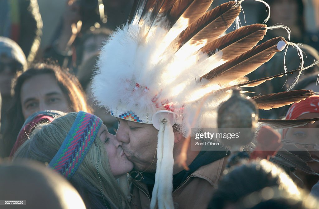 Native American and other activists celebrate after learning an easement had been denied for the Dakota Access Pipeline at Oceti Sakowin Camp on the edge of the Standing Rock Sioux Reservation on December 4, 2016 outside Cannon Ball, North Dakota. The US Army Corps of Engineers announced today that it will not grant an easement to the Dakota Access Pipeline to cross under a lake on the Sioux Tribes Standing Rock reservation, ending a months-long standoff.