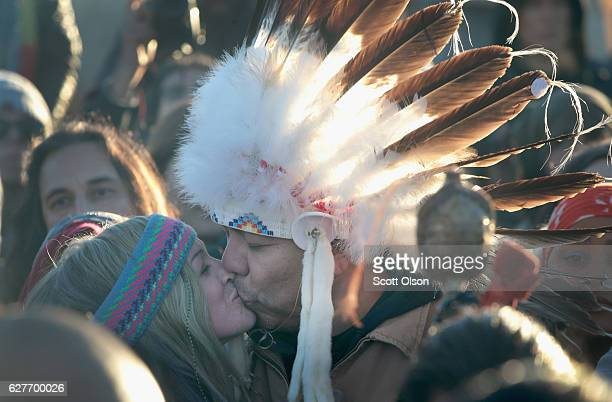 Native American and other activists celebrate after learning an easement had been denied for the Dakota Access Pipeline at Oceti Sakowin Camp on the...