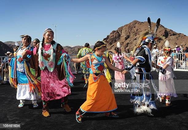 Native American children from the Red Hand Dance Troupe perform on the newly opened Mike O'CallaghanPat Tillman Memorial Bridge which spans the...