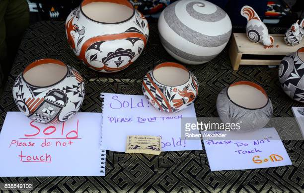 Native American clay pottery by Acoma Pueblo potter Franklin Peters sold quickly at the Santa Fe Indian Market in Santa Fe New Mexico The annual...