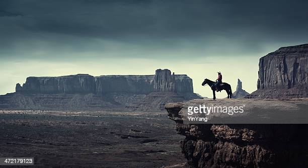 native american cowboy on horse at monument valley tribal park - wild west stock pictures, royalty-free photos & images