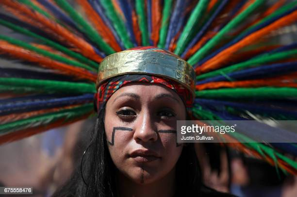 Native American dancers looks on during a May Day demonstration on May 1 2017 in San Francisco California Thousands are expected to take to the...