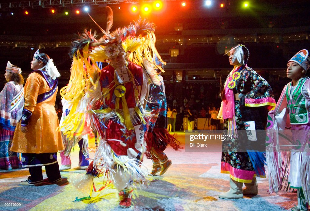 Native American dancers participate in the Grand Entry on the floor of the Verizon Center in Washington as the National Powwow gets underway on Friday, Aug. 10, 2007. The 3-days of drumming and dancing is organized by the Smithsonian National Museum of the American Indian.