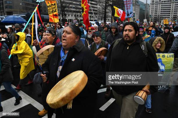 Native American drummers make their way along Pennsylvania Ave Hundreds of Native Americans and supporters protested the DAPL by taking to DC's...