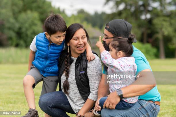 native american family playing together on a soccer field - indigenous peoples of the americas stock pictures, royalty-free photos & images
