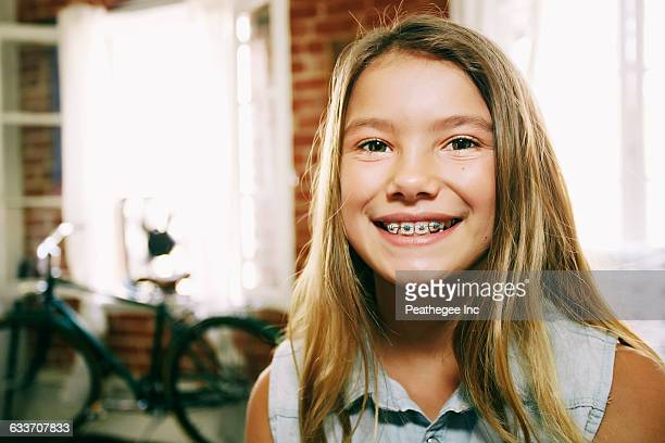 Native American girl smiling with braces