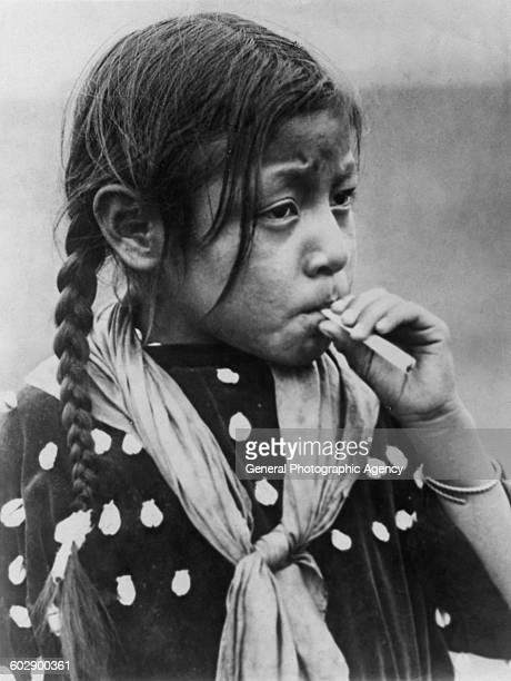 A Native American girl smoking a cigarette circa 1935