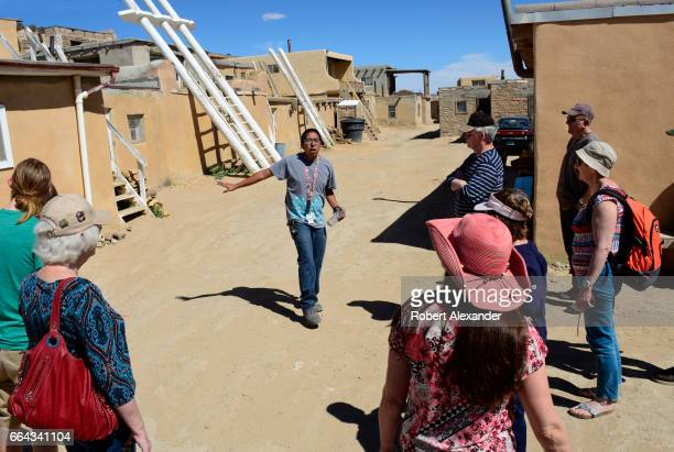 Native American guide talks with visitors at Sky City one of three villages which make up Acoma Pueblo west of Albuquerque New Mexico The village...