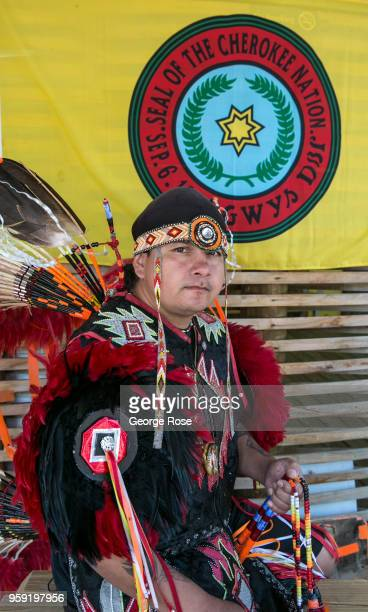 Native American in full head dress poses for pictures along the highway on May 11 2018 in Cherokee North Carolina Located near the entrance to Great...