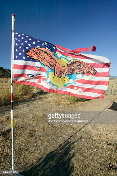 Native American Indian flag blows in wind on Chumash Indian land on highway 33 near Cuyama California