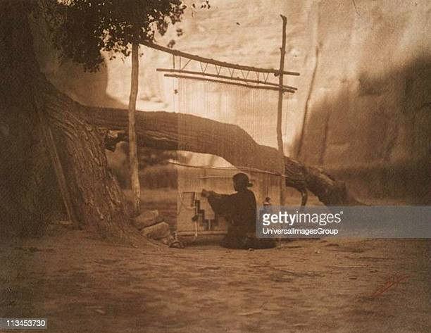 Native American Indian Navajo blanket weaver c1904 Woman weaving a blanket on a vertical loom Photograph by Edward Curtis