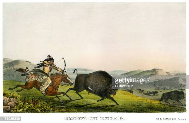 Native American Indians buffalo hunting in the great plains with bows and arrows Wild west American landscape