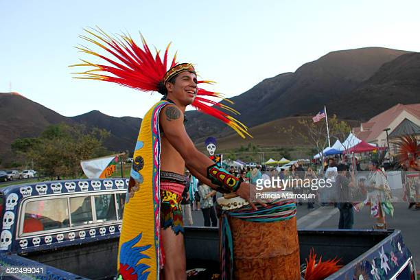 Native American leader prepares for a procession at a Dia de los Muertos celebration in Camarillo California in November 2013