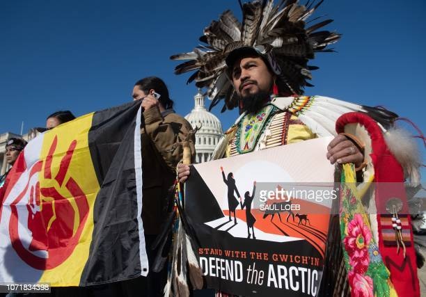 Native American leaders hold signs against drilling in the Arctic Refuge on the 58th anniversary of the Arctic National Wildlife Refuge during a...