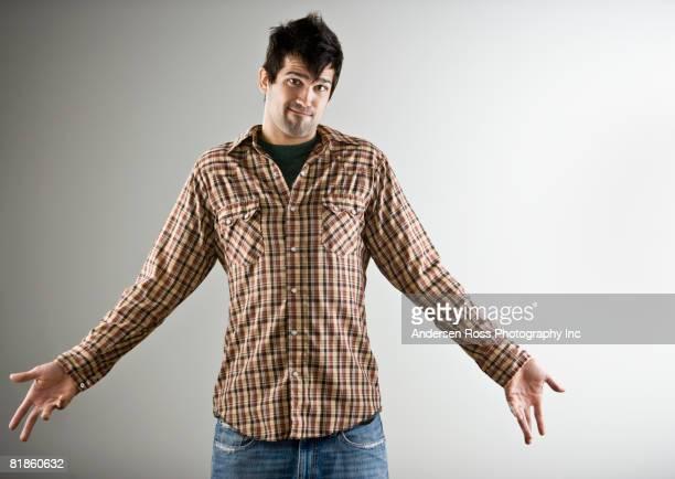 Native American man shrugging shoulders