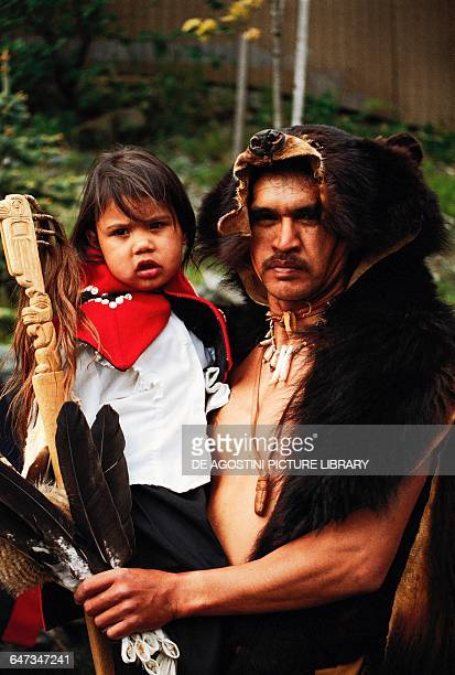 Native American man with child wearing traditional clothes Alaska United States of America