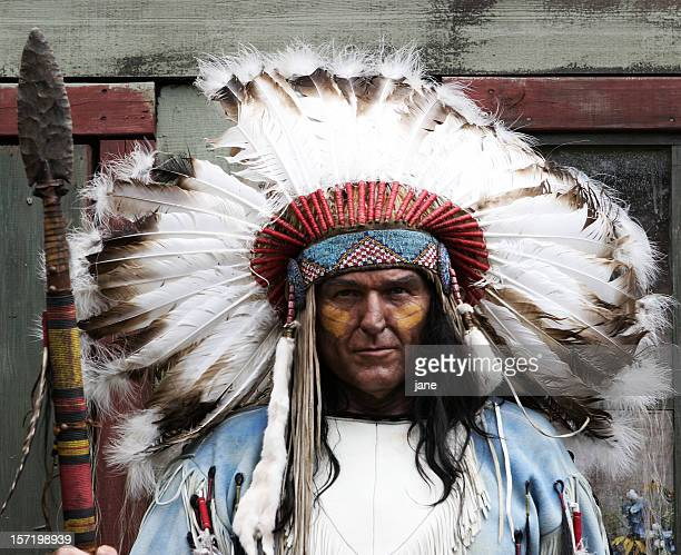Native American man with feather headdress and spear