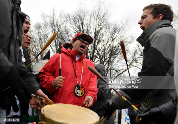 Native American men beat on a ceremonial drum during the Dakota Access Pipeline protest outside the White House on March 10 2016 in Washington DC