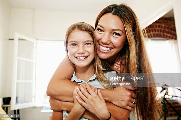 Native American mother and daughter hugging