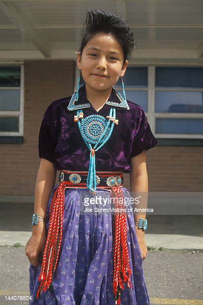 Native American Navajo girl wearing colorful dress and jewelry Blanding southern UT