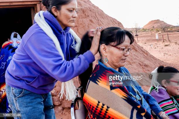 Native American Navajo Woman Styling Another S Hair In A Traditional Style