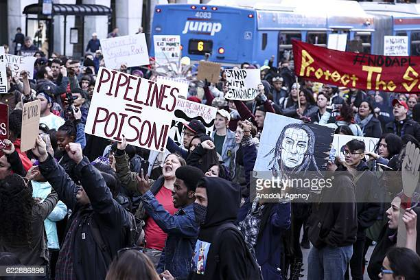 Native American protestors are joined by antiTrump and other protestors as they march showing their opposition to the Dakota Access Pipeline in...