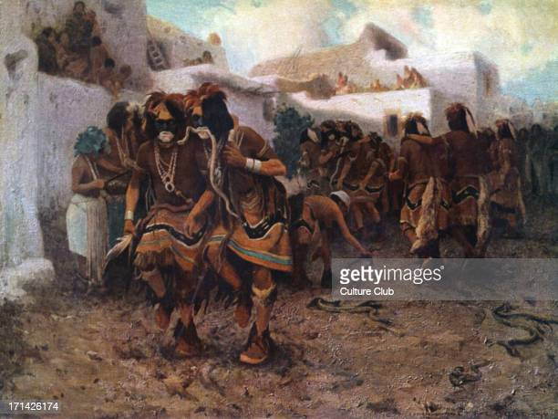 Native American snake dance of the Hopi tribe a prayer for rain Men handling poisonous rattlesnakes one even holding a snake between his teeth Pueblo...