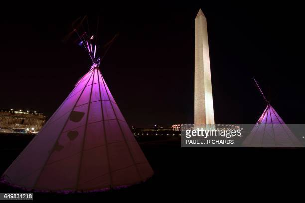 TOPSHOT Native American teepees are seen on the National Mall in downtown Washington DC on March 8 with the National Monument to the rear as tribes...