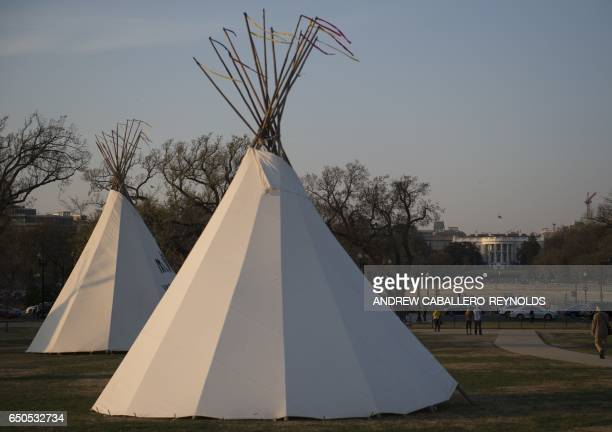 Native American teepees are seen on the National Mall in downtown Washington DC on March 9 with the White House to the rear as tribes from around the...