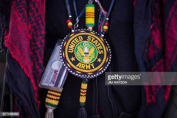 A Native American US Army veteran wears a beaded necklace at the Oceti Sakowin Camp on the edge of the Standing Rock Sioux Reservation on December 3...