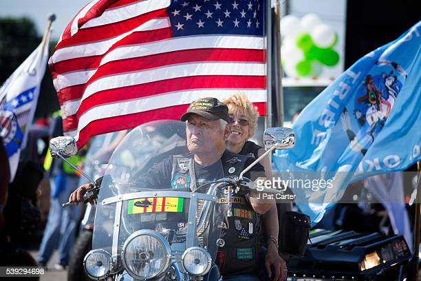 Native American Vietnam Veteran and his wife ride in the Red Earth Native American Festival parade Friday June 10 2016 in Oklahoma City