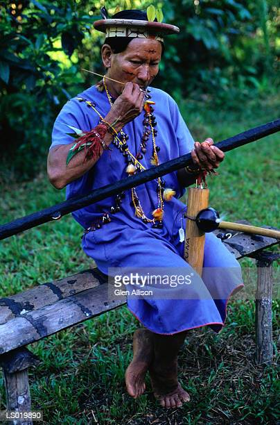 native american with blowpipe - blowpipe stock pictures, royalty-free photos & images