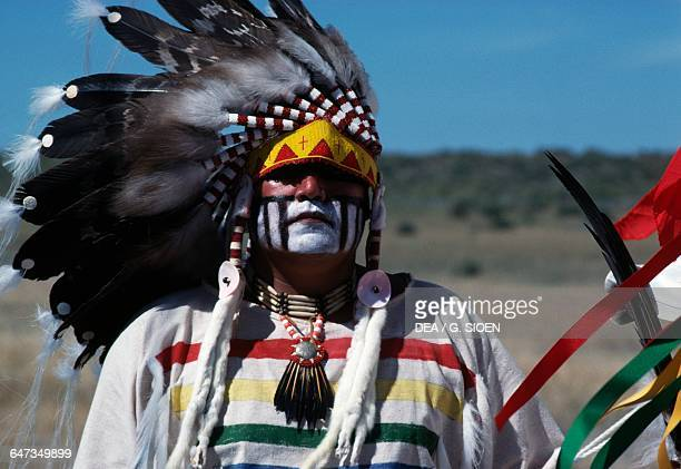 Native American with painted faces wearing traditional clothes and feather headdresses annual commemoration of the Battle of Little Bighorn Montana...