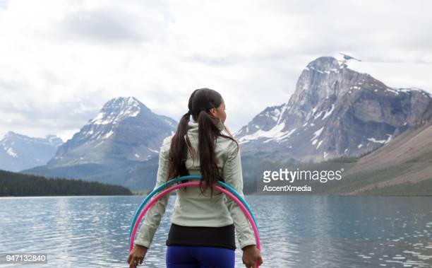Native American woman dances with hoops, in mountains
