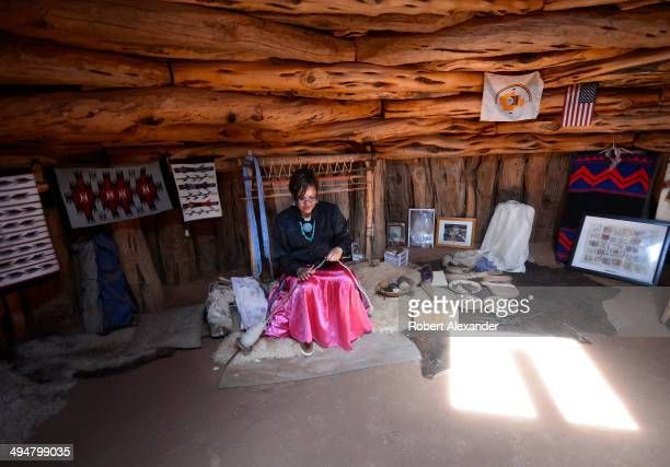 Native American woman in a traditional Navajo home demonstrates how she makes yarn used to weave wool blankets The demonstration is included in tours...