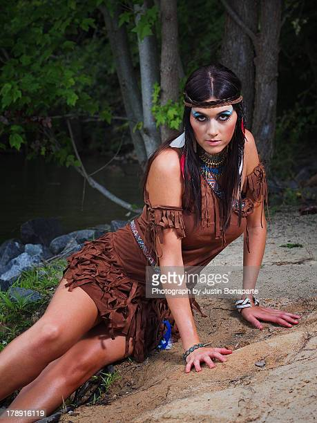 native american woman on lake shore - charlotte long stock pictures, royalty-free photos & images
