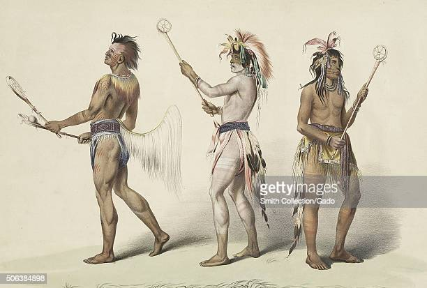 Native Americans holding primitive lacrosse sticks and preparing to play a game illustration 1888 From the New York Public Library