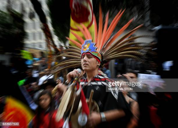 Native Americans lead demonstrators as they march to the Federal Building in protest against President Donald Trump's executive order fasttracking...