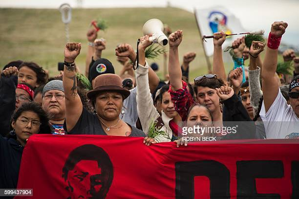 Native Americans march to a burial ground sacred site that was disturbed by bulldozers building the Dakota Access Pipeline , near the encampment...