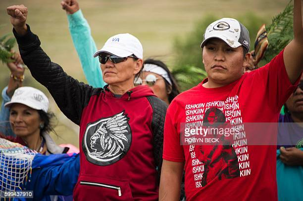 Native Americans march to a burial ground sacred site that was disturbed by bulldozers building the Dakota Access Pipeline near the encampment where...