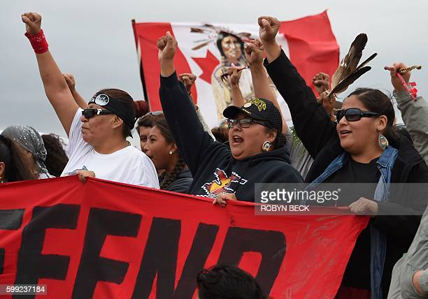 Native Americans march to a sacred burial ground that was disturbed by bulldozers building the Dakota Access Pipeline near the encampment where...