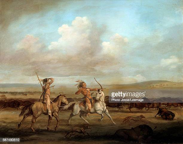 Native Americans on horseback hunting bison Painting by George Catlin 19th century Museum of the New World La Rochelle France