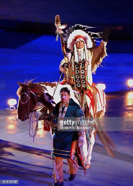 Native Americans perform 08 February 2002 during the opening ceremonies of the 2002 Winter Olympics at the Rice Eccles Stadium in Salt Lake City,...