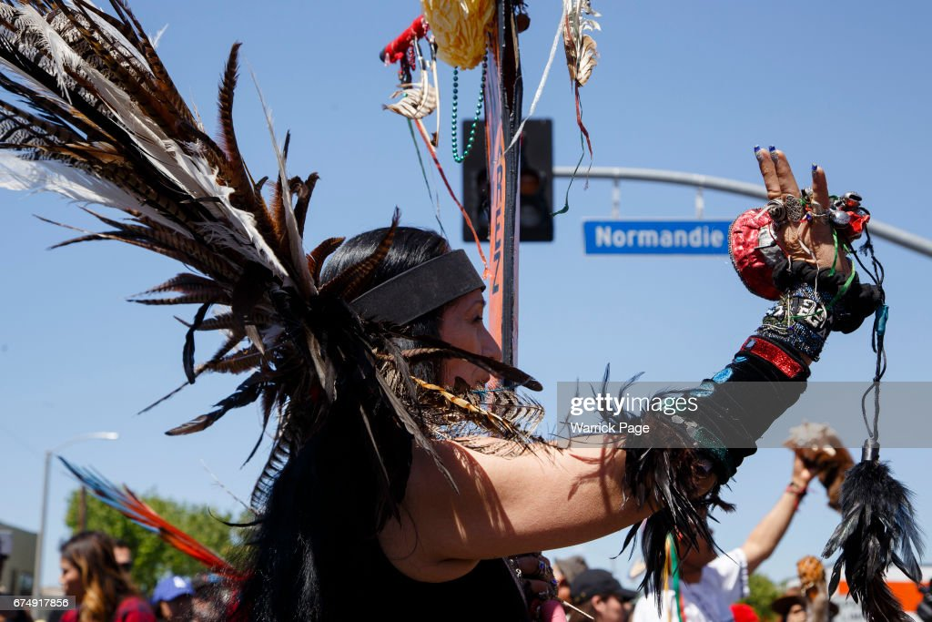 Native Americans perform a tribal ceremony before a peace rally at the intersection of Florence and Normandie, on the 25th anniversary of the LA riots, on April 29, 2017 in Los Angeles, California. Florence and Normandie was the flashpoint for the riots that was sparked by the police acquittals in the Rodney King beating.