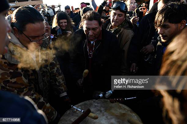 Native americans play drums to celebrate their victory after Sioux Chief Arvol Looking Horse announced, to members of over 300 nations, that the US...