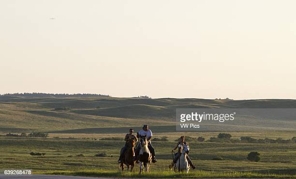 Native Americans riding horses near Highway 18 on the Rosebud Indian Reservation Parmelee South Dakota